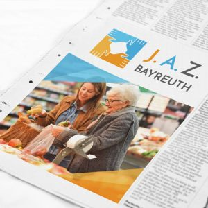 Ein Zeitungsausschnitt mit einem Bild vom J.A.Z. Bayreuth